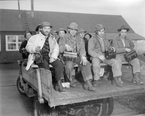 CVA-586-3707-Workers holding lunch boxes in back of truck at] Pacific Mills [on the] Queen Charlotte Islands-1945