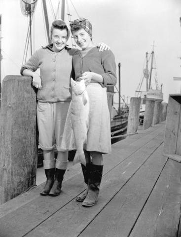CVA-586-972-Female Cannery workers [on dock] hold salmon-1943_