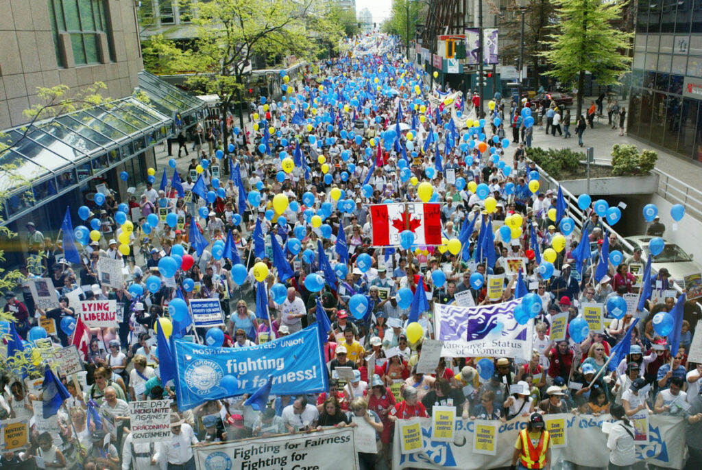 A huge crowd turned out for the May 1, 2004 May Day Rally, holding blue balloons and banners in support of the HEU.
